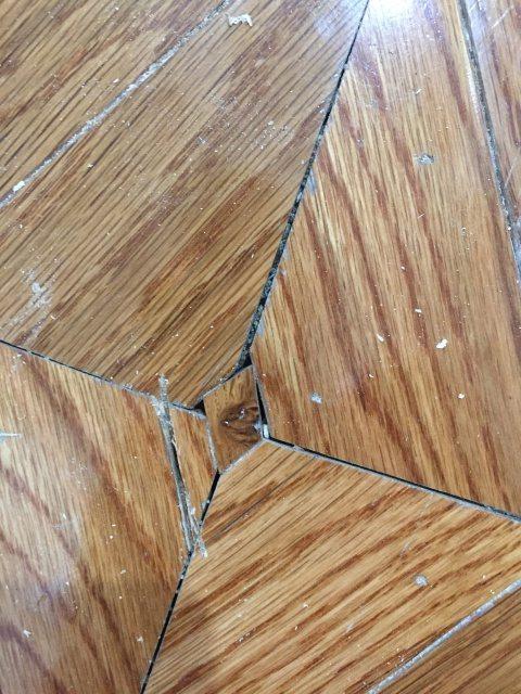 Replacing decorative flooring insert