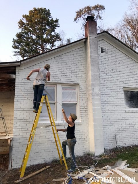 Painting a brick house with an airless sprayer