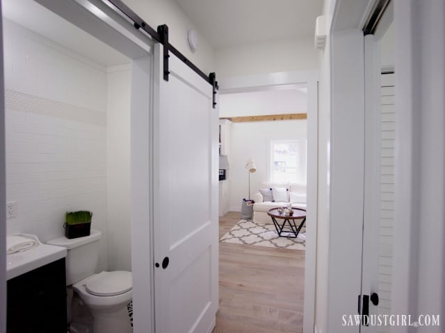 hallway and bathroom with barn door