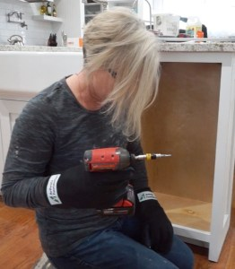 Building cabinet with arthritis simulation gloves