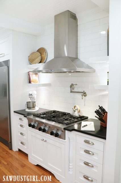 Kitchen reveal with cooktop cabinet decorative legs