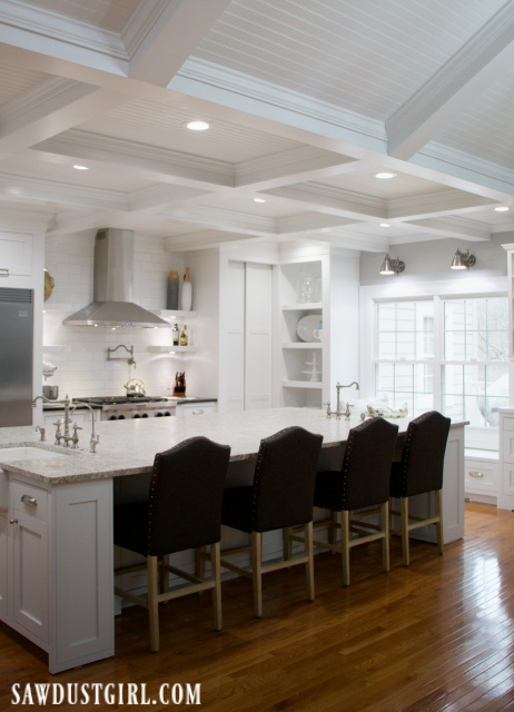 Box beam ceiling in white kitchen
