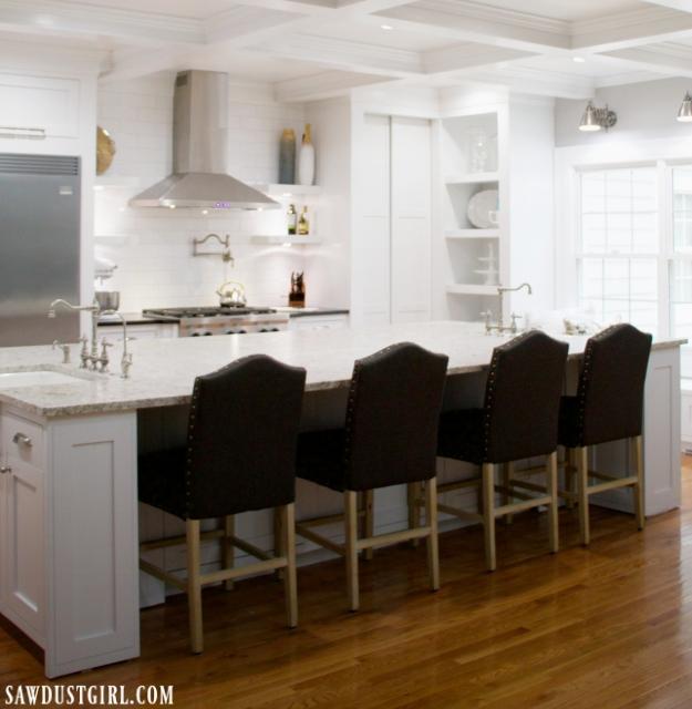 Lots of hidden storage under kitchen island with hidden cabinet doors.