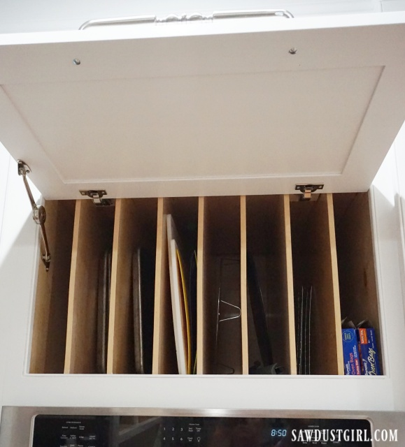 Cabinet door that lifts up and stays open