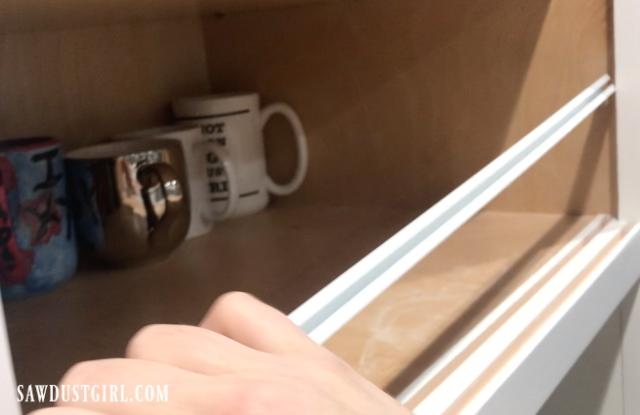 Sliding cabinet door track