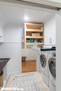 laundry room with deep storage above the washer and dryer