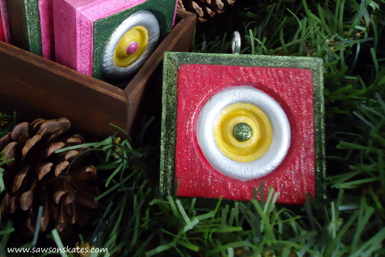 Inspired by vintage glass ornaments, cheap wood rosettes are transformed into DIY Christmas ornaments with the use of metallic and glitter paints. The ideas are endless! So easy and they make great gifts!