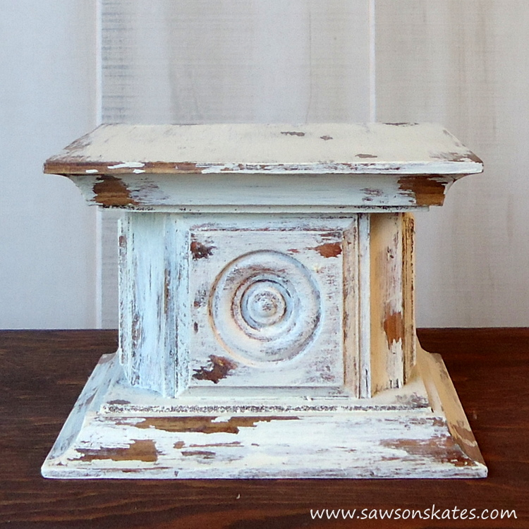 Scrap wood and an easy chippy paint finish come together for this chippy paint wood rosette DIY candle holder!