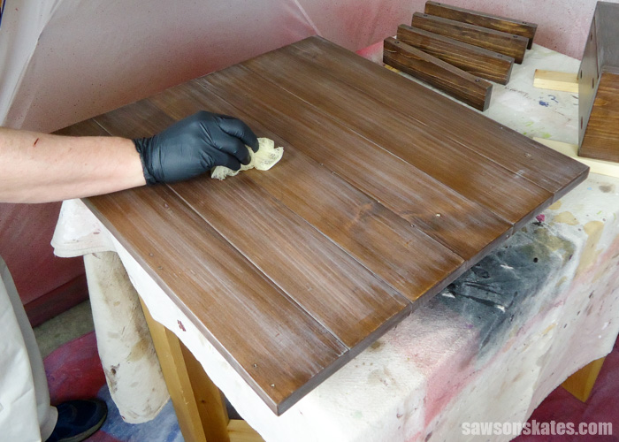 How to spray polyurethane - use a tack cloth to remove the remaining poly dust