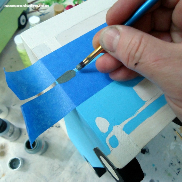 This simple trick will make you look like a freehand painting pro - Use painter's tape for straight lines
