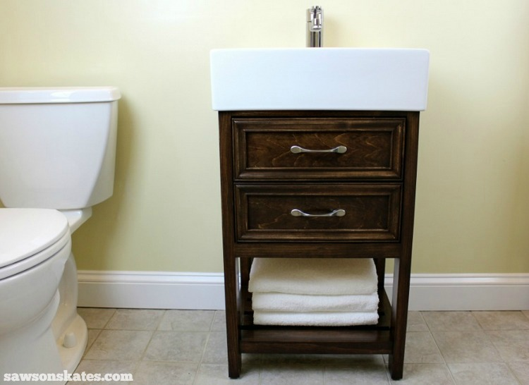 Check out the plans for this small DIY vanity. It features book-matched panels, faux drawers and an IKEA Yddingen sink. It's BIG on style, but fits in a small space!