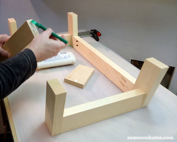 Place the long stretchers and leg sub assemblies on your workbench. Apply glue to the long stretchers, clamp to leg sub assemblies and attach using 1-1/2