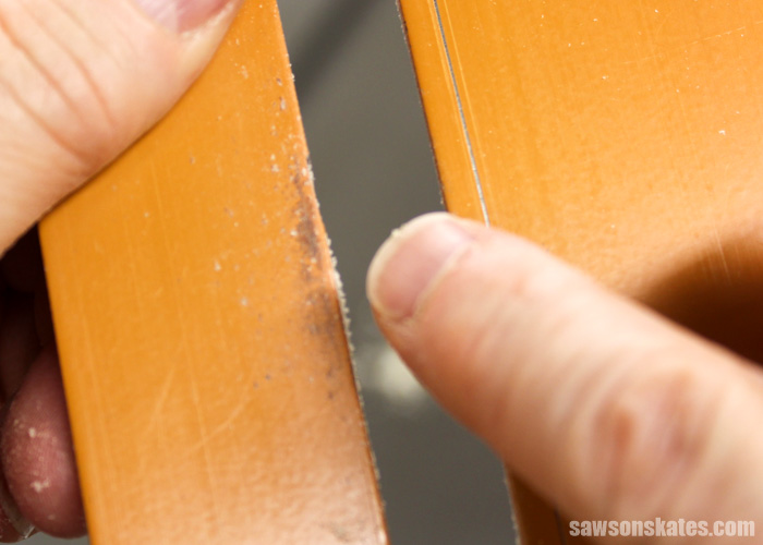 Wax your table saw to remove pitch and resin that builds up over time