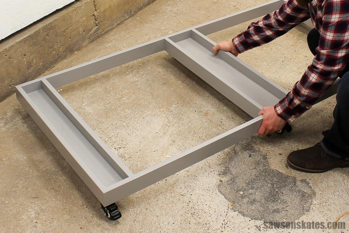 Ultimate Workbench for a Small Workshop - the DIY rolling base lifts out of the way to free up floor space