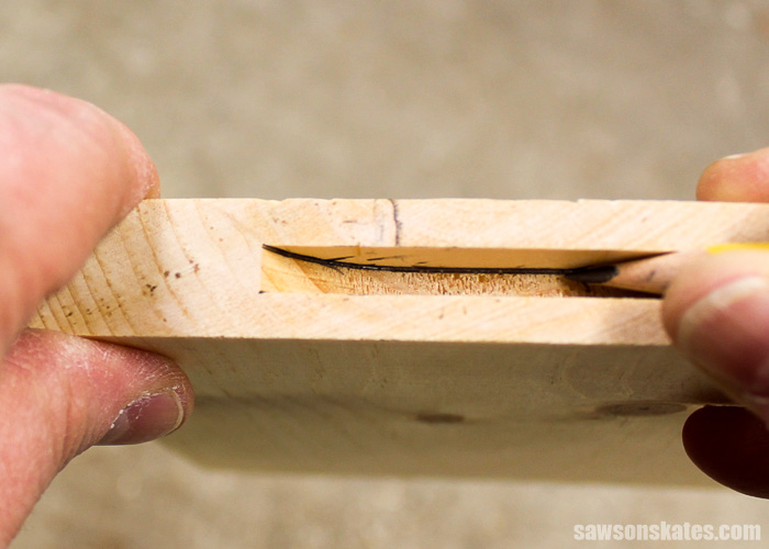 Make a Door with Pocket Holes - the slot cutting bit leaves a curve at the end of the dado