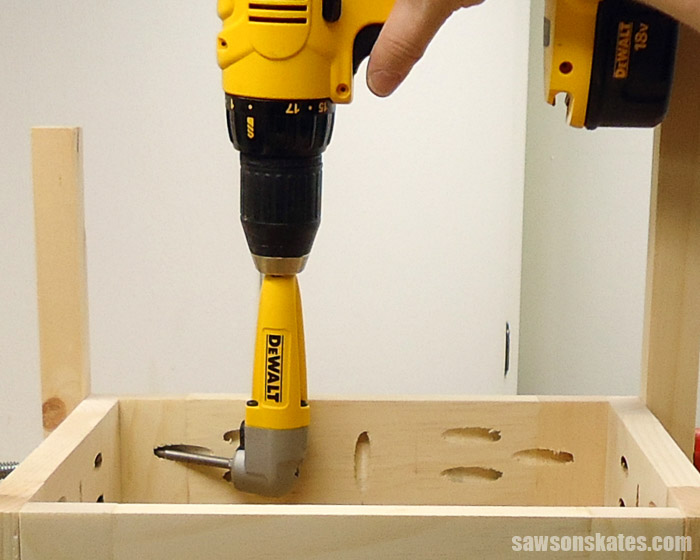 A right angle attachment allows a drill to fit into tight spaces