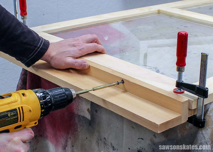 DIY wood storm windows can be installed with store bought hangers or DIY hangers