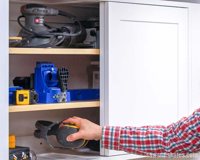 Use these free DIY cabinet plans with adjustable shelves and sliding doors made with a Kreg Jig to add space-saving tool storage to your small workshop!