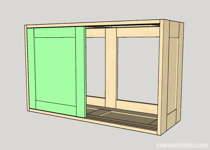Installing the first sliding door in a DIY tool storage cabinet