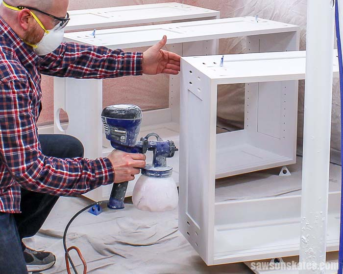 Learn how to spray paint indoors without making a mess! Use these simple tips to spray furniture and DIY projects inside without getting paint everywhere!
