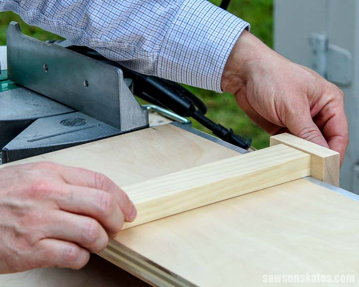 This portable DIY miter saw station has a stop system for repetitive cuts.