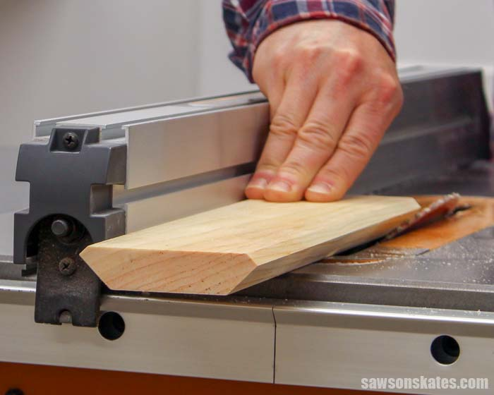 Making crown molding on the table saw by cutting two wide 45-degree bevels after cutting two narrow bevels