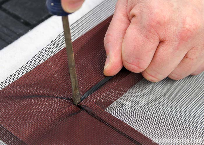 Inserting window screen spline into a groove
