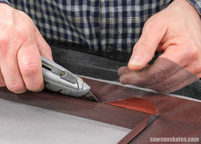 Cutting excess window screen material