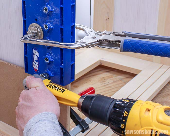 Using a drill to drill shelf pin holes to make adjustable shelves