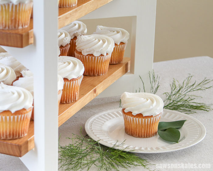 A DIY cupcake stand with a cupcake on a white plate