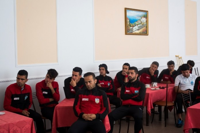 Members of the Kurdistan team listen to a speech from their manager in the dining hall of their hotel on June 2, 2016 in Sukhumi, Abkhazia. Kurdistan, which was comprised of Iraqi Kurds and brought one of the largest delegations to the tournament, was one of the early favorites to win the tournament but were eliminated by Padania on penalties in the quarterfinals. (Pete Kiehart for ESPN)
