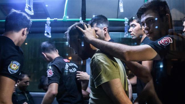 Turkish anti riot police officers detain a Turkish soldier who allegedly took part in a military coup as they are leaving in a bus the courthouse at Bakirkoy district in Istanbul on July 16, 2016. (AFP)