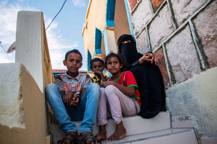 Thirteen-year-old Salim (far left) sits with his siblings in their temporary accommodation in Hargeisa, capital of Somaliland. Salim saw his friend's face blown off when he picked up a grenade in Yemen in 2015. Salim's mother Daifa says her son hasn't been the same since the incident. Daifa herself has a chronic blood pressure problem, but can't afford treatment in Somaliland. Ashley Hamer