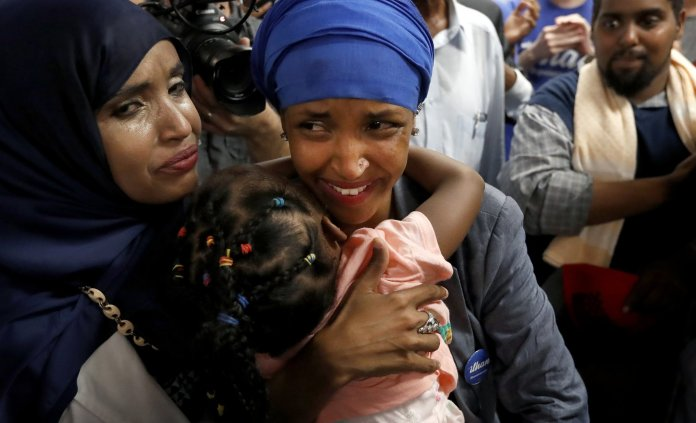 Ilhan Omar was greeted by supporters at Kalsan in Minneapolis.
