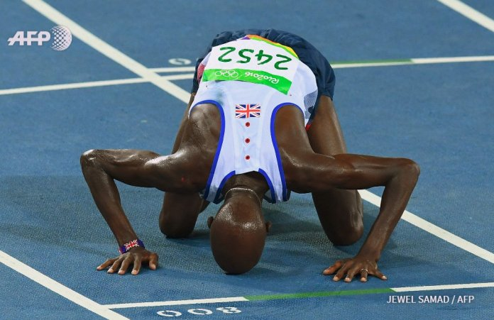 Bruised but never beaten: Farah picked up a nasty cut on his shoulder after the tumble but charged on to 10,000m victory