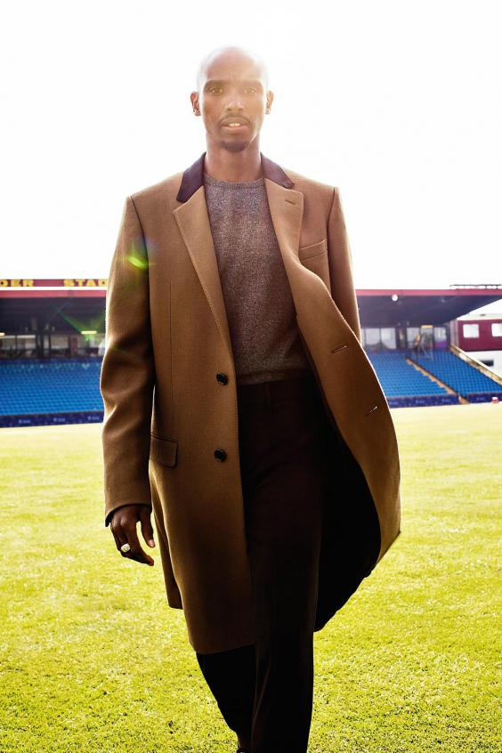 LANVIN coat, £1,456, at matchesfashion.com. Jumper, trousers and ring, as before (Jonathan Glynn-Smith)