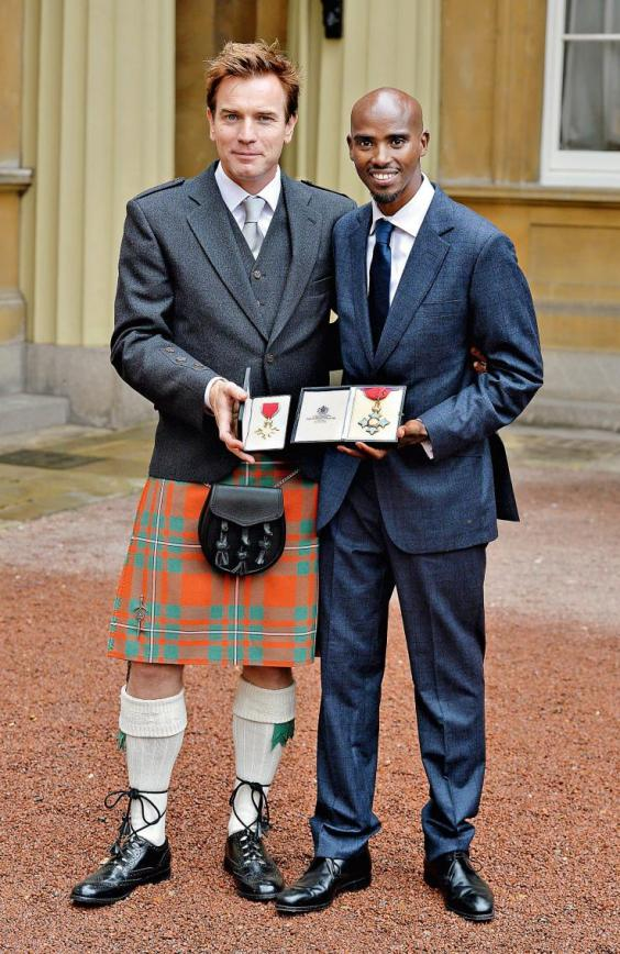 Farah joins the actor Ewan McGregor with his CBE at Buckingham Palace