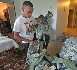 "ELIZABETH FLORES • EFLORES@STARTRIBUNE.COM Mahamoud Ibrahim packed for Army Reserve training. ""I am no danger to the community,"" he said."