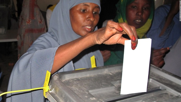Photos: New member in family of nations? A woman casts her ballot during the 2010 elections that saw President Ahmed Mohamed Mohamoud Sillanyo elected.