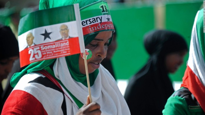 Photos: New member in family of nations? Woman waves flag during celebrations of the 25th anniversary of Somaliland's declaration of independence in the capital, Hargeisa on May 18, 2016. Despite the declaration, Somaliland is still considered an autonomous region of Somalia by the United Nations. But President Ahmed Mohamed Mohamoud Sillanyo is pushing hard for recognition of full sovereignty.