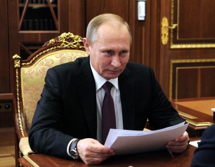 Russian President Vladimir Putin celebrates Trump's victory this morning in the Kremlin. (Sputnik)