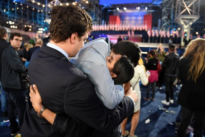 People embrace at Clinton's election night event at theJavits Center in New York. (Jonathan Newton/The Washington Post)