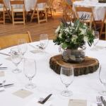 Wood Slices Framing Centerpiece Florals