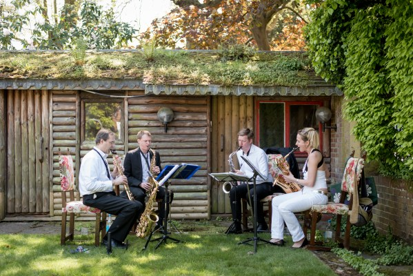 Nathan Hassall's Java Saxophone Quartet performing at a garden party in north London, in May 2018.