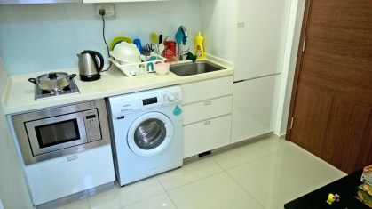 the kitchen, and yes, the laundry machine is in the kitchen :D