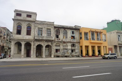 The two sides of Havana, the orange building is private owned restaurant and next to it old government owned building nobody takes care of