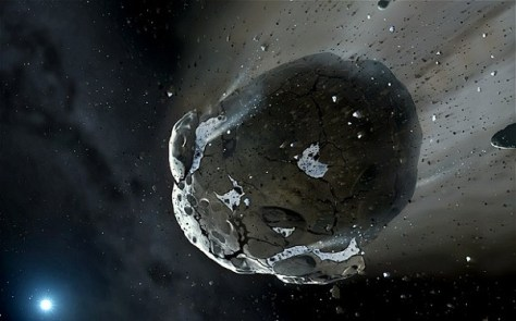 Artist's impression of a rocky and water-rich asteroid being torn apart by the strong gravity of the white dwarf star GD 61 (Credit: Mark A. Garlick, space-art.co.uk, University of Warwick and University of Cambridge)