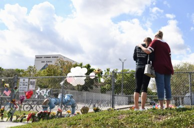Mourners gather at a makeshift memorial outside Marjory Stoneman Douglas High School in Parkland, Florida. (Matt McClain/Washington Post via Getty)