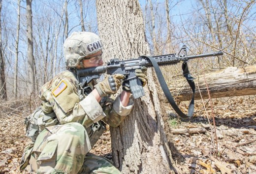 Cadet Taylor England fires her M4 carbine at a target during the Sandhurst Military Skills Competition at West Point, New York, April 14, 2018. England was the top-ranked infantry-bound cadet in the class of 2018. (U.S. Army photo)