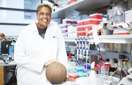 """For 19 years, the Cedars-Sinai laboratory investigator of inflammatory bowel disorders and immunobiology concentrated on studying the human microbiome—the ecosystem of microorganisms, bacteria, fungi and viruses that naturally live within the human gut. Her glory days as a forward and center for collegiate and professional teams were behind her. And then she got a phone call that returned her to the hardwood courts of her youth. On June 9, Lisa Thomas will be one of 96 players from the now-defunct Women's Professional Basketball League to be inducted as """"Trailblazers"""" into The Women's Basketball Hall of Fame. PHOTO CREDIT: Cedars-Sinai"""